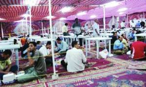 A variety of people take advantage of free iftar tents during Ramadan.  (Jordan Times)