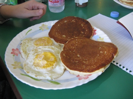 Two Golden Brown (and delicious) Pancakes and Two Eggs (yes my family likes them well-cooked) at the Bake House