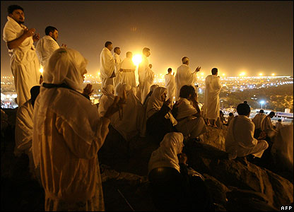 Muslim pilgrims holding a nighttime vigil on the Mountain of Arafat
