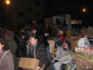 People in Jordan donating and loading a truck with relief aid for Gaza