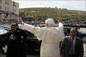 Pope Benedict greets onlookers near community center in Amman