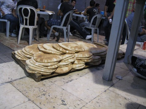 Fresh warm bread!  Too bad there isn't a scratch and sniff feature for blogs.  One of the great things about Amman is you can eat the best pita in the world everyday.  You're never far from a bakery.